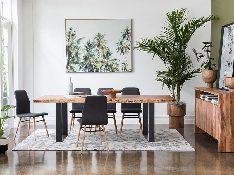 Using palm plants in the corner of the room.
