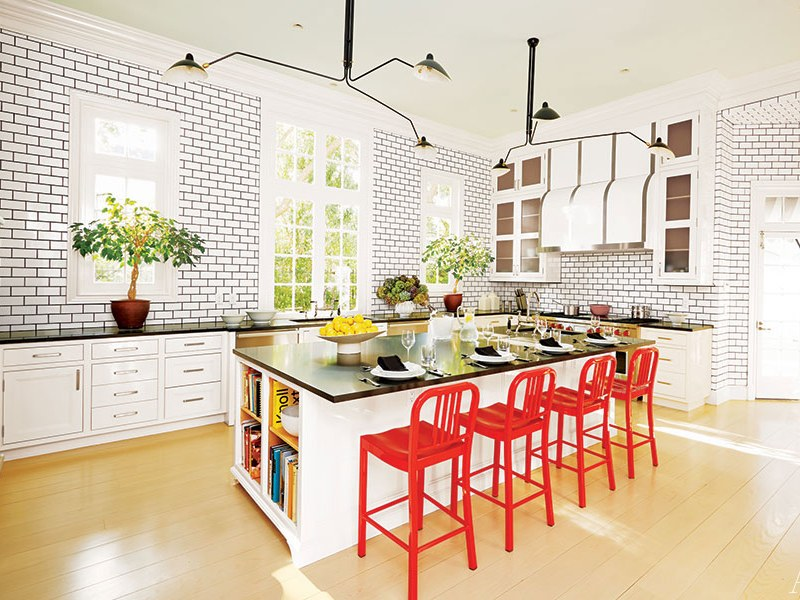 Use red items to make the kitchen interesting.