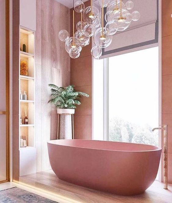 beautiful pink bathroom with pink nude-colored bathtub