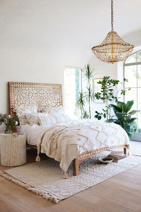 comfortable and fresh bedroom with plants decoration