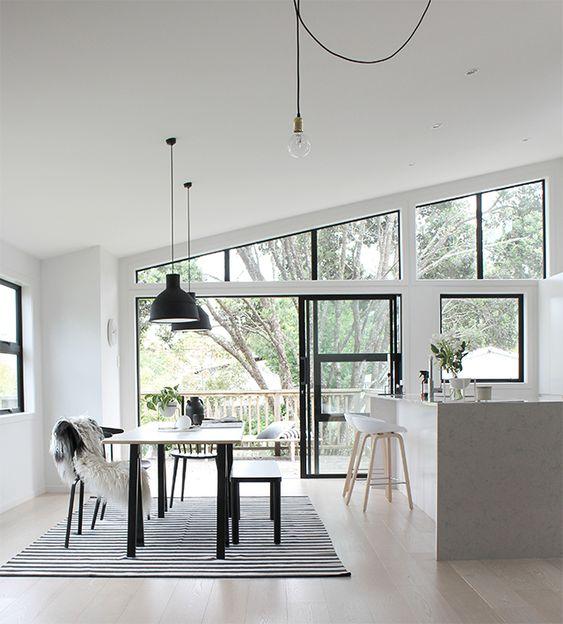 large window monochrome dining room