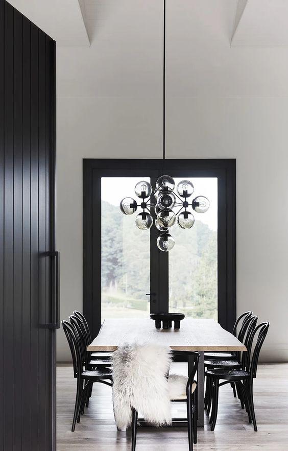glass door monochrome dining room