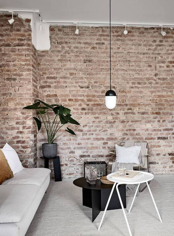 exposed brick wall living room decor